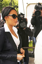 Lindsay arrived to court in a tailored black pantsuit paired with classic cateye sunglasses.