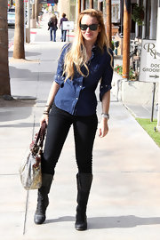 Lindsay wears a denim button-down shirt while out shopping.