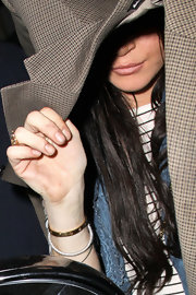"Lindsay wore the 18 carat gold ""Love"" bangle bracelet while hiding from the paps."
