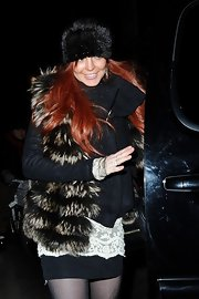 Lindsay Lohan bundled up to the max in this fuzzy fur vest.