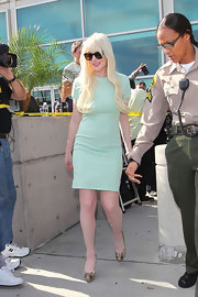 Lindsay Lohan wore this simple mint dress with stacked snakeskin platforms to the courthouse in LA.