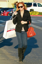 Lindsay Lohan stayed low key on a trip to the outlets in a pair of suede slouchy boots.