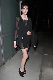 Ali Lohan got a boost from a pair of black suede wedge booties.