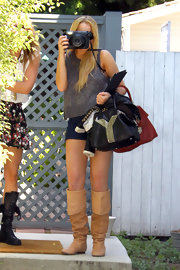 Lindsay Lohan showed off her YSL handbag while taking some pictures of her own.