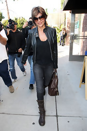 Lisa Rinna's edgy black leather motorcycle jacket adds an element of cool to her already stylish jeans, t-shirt and boots ensemble.