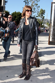 Lisa Rinna turns some heads wearing distressed leather motorcycle boots. She certainly doesn't sacrifice looks for comfort with this buckled footwear.