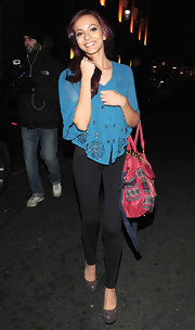 Jade Thirlwall looked oh-so-pretty in a sheer blue blouse decorated with beads in a swirly pattern.