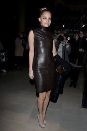Nicole Richie dazzled at the Givenchy fashion show in snakeskin platform pumps.