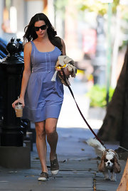 Liv Tyler walked her dog in a pair of olive canvas sneaks with white toes.