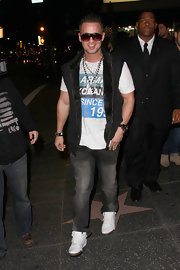 Mike wears a fur linked vest over his graphic tee for his outing in Hollywood.