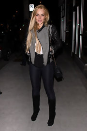 Lindsay Lohan hit the town wearing a pair of sleek suede knee high boots.