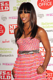 Alexandra Burke rocked sleek straight tresses with bangs that peaked past her brows at a London event. Her locks were highlighted with subtle brown hues.