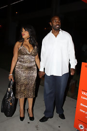 Niecy went wild in leopard print in this shining deep plunging cocktail dress.