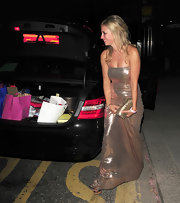 Holly Branson was spotted back home after their engagement party wearing a glitter gown.