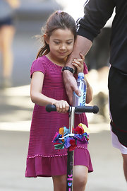 Ava Jackman was cute as a doll in her striped fuchsia dress.