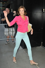 Snapped mid-stride as she arrived at the 'Good Morning America' show, LuAnn de Lessep showed off her slim pins in a pair of blue skinny jeans.
