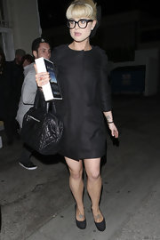 Kelly Osbourne got a boost from timeless black platform pumps. The jacquard heels matched Kelly's mod wool coat.
