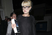 Lucky lady Kelly Osbourne bags an IPad for her 26th birthday as she celebrates with close friends and family in Los Angeles. Kelly left her 'favourite' Chinese restaurant Shanghai Grill in Beverly Hills with dad, Ozzie and mum Sharon.