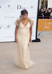 Star Jones chose a gold gown and fur bolero for her elegant look at the American Ballet Spring Gala.