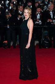 Ludivine Sagnier chose this column-style black gown with a mesh cutout skirt for her look at the premiere of 'La Venus a la Fourrure.'