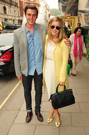 Caggie Dunlop posed with a friend wearing a classic sheer dress while out in London.