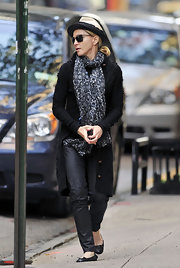 Madonna wears a long patterned scarf with her warm winter wear.