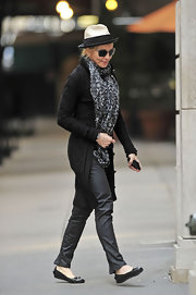 Madonna bundles up in a thick knee length black cardigan.  The thick knit sweater design and texture is beautiful.