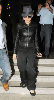 Madonna wore a fitted black leather jacket with her fedora for this eclectic look.
