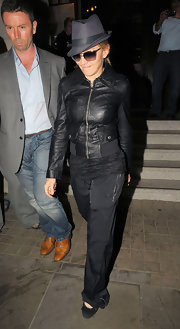 Madonna went for an incognito look with dark sunglasses and a classic fedora.
