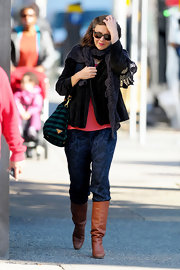 Maggie Gyllenhaal was out and about in NYC in a casual ensemble. The starlet donned printed pants paired with tan knee-high boots.