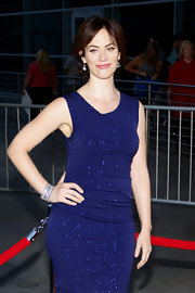 Maggie Siff styled her look with diamond bracelet at a movie premiere.