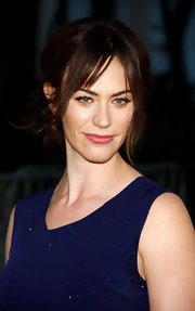 Maggie Siff made a dramatic entrance at the FX Network's 'Sons of Anarchy' premiere with a great set of eyelashes. To recreate her look, we recommend applying black eyeliner liberally along the upper lash lines, then lightly adding a pair of false lash strips.