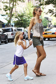 Heidi Klum kept her look casual in SoHo in a pair of tan leather sandals.