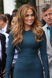 Jennifer Lopez showed off her amazing figure in a body-con dress, but check out her luscious locks! She styled her honey-brown mane in soft waves.
