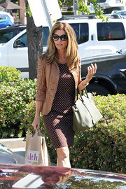 Maria Shriver looked daytime chic with a sage green pebbled Hermes Birkin.