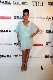Courtney Mazza rocked a sea foam-colored draped mini dress while at the North American Hairstyling Awards.