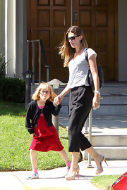 Stylish mom Rhea Durham walked outside a church wearing a tee, loose cropped pants, and a pair of platform slingbacks.