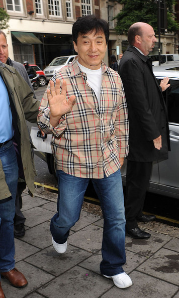 Jackie Chan paired his dark jeans with a plaid button down shirt.