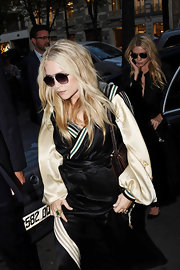 Ashley Olsen wore her hair in long casual waves with a center part during Fashion Week in Paris, France.