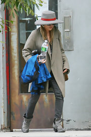 The actress went incognito sporting a menswear-inspired ensemble, including a pair of gray, side-zip ankle boots.