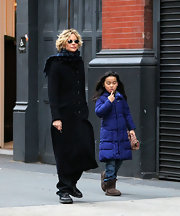 Meg Ryan hit the town sporting this long wool coat with a double row of buttons.
