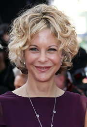Meg Ryan showed off her curly bob while walking the red carpet at Cannes.