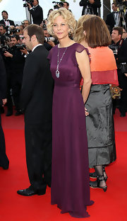 Meg Ryan made a classic appearance at the Cannes Film Festival, where she donned a vibrant purple evening gown.