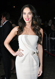 Megan Fox's dark red nails pop against her pale evening gown.