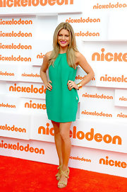 Natalie Bassingthwaighte put on a summery vibe by wearing a green dress and a pair of yellow strappy kicks at the Nickelodeon Kids Choice Awards.