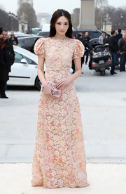 A soft pink floral dress looked feminine and ethereal on Pace Wu Pei Ci at Valentino's runway show in Paris.
