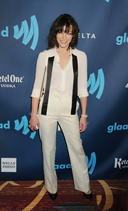 Milla Jovovich topped off her timeless look with a white button down.