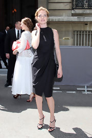 Natalia Vodianova was a vision in Paris wearing this draped LBD at the Dior show.