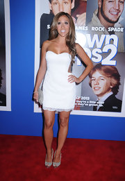 Melissa Gorga kept it simple and sweet with a strapless white frock with illusion panels on the sides and lace trim at the hem.