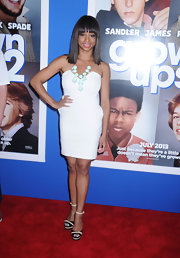Monique Coleman bared her shoulders with this V-neck strapless frock in a crisp white.